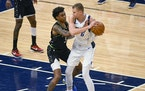 Timberwolves forward Jaden McDaniels guarded Mavericks center Kristaps Porzingis here, but he saved some of his best defense Wednesday night for tryi