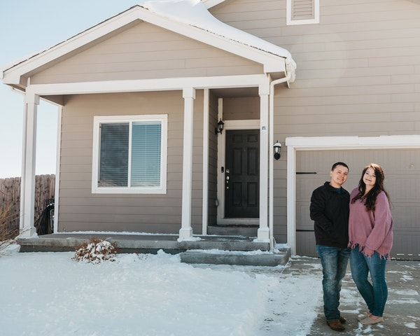 Army Staff Sgt. Shaun Horton and his wife, Kassi, in front of their new first home in Colorado Springs, bought online. A change in assignment for Sgt.