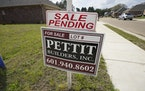 "A ""sale pending"" sign stands along side a housing lot in Madison County, Miss., Tuesday, March 16, 2021. U.S. long-term mortgage rates continued t"