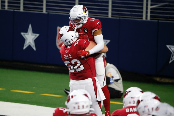 Mason Cole (52) celebrated a touchdown with Christian Kirk (13) for Arizona in October.