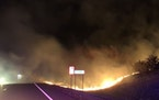 A grass fire burned about 7 acres Sunday just north of Cold Spring, closing a county road.