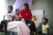 Howanda Williams showed the bedroom she decorated for her oldest daughter Mary, left, who is 8, in their new apartment. Also pictured are William's