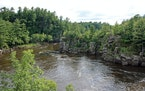 The St. Croix River cuts through a basalt gorge known as the Dalles of the St. Croix in St. Croix Falls. The dramatic rock walls are part of Interstat