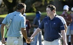 Dustin Johnson (left) shook hands with Bob MacIntyre after Johnson had to rally late for a tie in the Dell Technologies Match Play in Austin, Texas, o