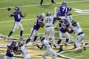 Vikings offensive line and quarterback Kirk Cousins during a September game against the Titans.