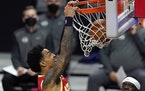 Atlanta Hawks forward John Collins dunks during the first half of an NBA basketball game against the Los Angeles Clippers on Monday.