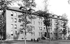 "An exterior shot of Loras Hall taken in 1895 at an open house for the St. Paul Seminary. The building was still called ""North Dormitory"" at that t"