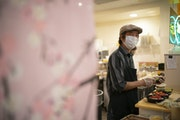Jun Abematsu smiled at a regular customer from behind the counter at his Sushi Takatsu in the Baker Center.