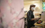 Jun Abematsu smiled at a regular customer from behind the counter at his Sushi Takatsu in the Baker Center.