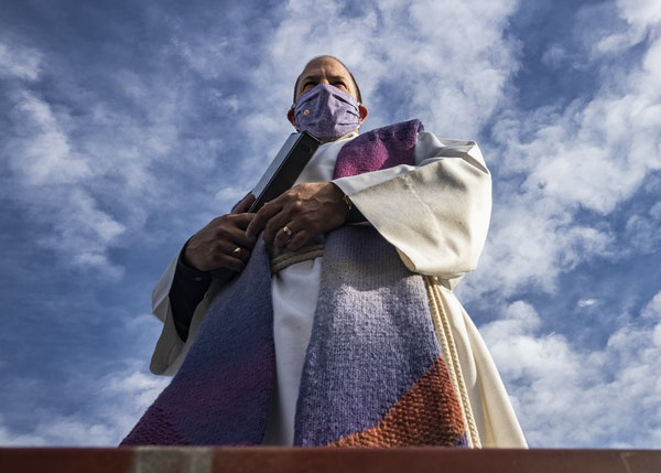 The Rev. John D.F. Nelson led services from the rooftop of Gethsemane Lutheran Church in Hopkins so that all who attended could see. He expects roofto