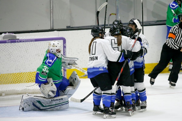 Whitecaps players celebrated after scoring against Connecticut goalie Abbie Ives during the second period Friday in Boston.