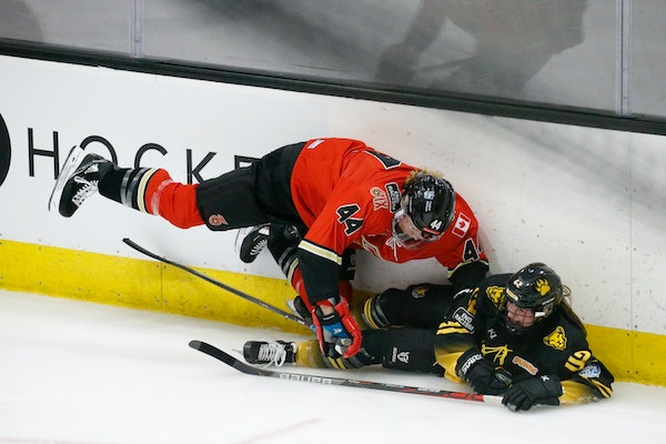 Toronto Six defender Lindsay Eastwood (44) and Boston Pride forward Meghara McManus (42) crashed along the boards during the third period Friday.