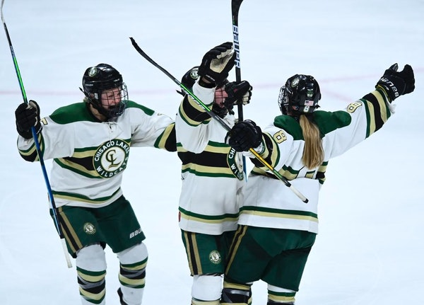 From left, Chisago Lakes defenseman Laine DeVries (15) and defenseman Grace DeVries (21) celebrated with forward Dani Burgen (8) after Burgen scored h