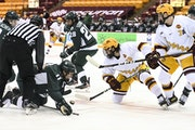 Gophers seniors Scott Reedy, center, and Brannon McManus (7) will try to help the team take a step toward the Frozen Four.