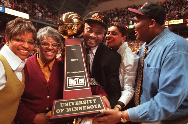 Lori, Yevette, Clem, Clemette and Brent Haskins all got their arms around the Big Ten trophy during a home celebration before the Gophers' final hom