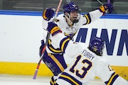 Minnesota State Mankato's Ryan Sandelin, back, celebrated his overtime goal with Brendan Furry on Saturday after the Mavericks came from behind to b