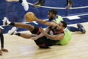 Rockets forward Sterling Brown passed the ball after getting it from Wolves guard Jaylen Nowell in the second half Saturday.