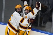 Gophers forward Mason Nevers, right, celebrates his goal with Jack Perbix during the first period against Nebraska Omaha on Saturday night in Loveland