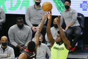 Wolves rookie Anthony Edwards shot over former Wolves player Justin Patton during the fourth quarter Saturday, when Edwards scored 27 points but Houst