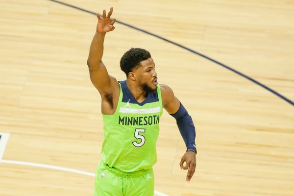 Wolves guard Malik Beasley gestured after hitting a three-pointer against the Rockets on Saturday, his first game since Feb. 24.