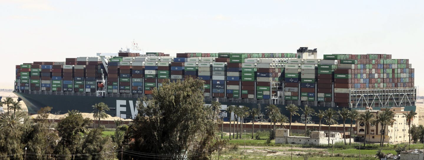 The Ever Given, a Panama-flagged cargo ship blocks the Suez Canal almost a week after it got stuck sideways in the crucial waterway, Monday, March 29,