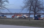 Responders and search crews gather at Little Wall Lake Sunday evening, March 28, 2021, after five members of the Iowa State Crew Club were involved in