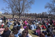 More than 100 people gathered in front of the Minnesota Capitol on Monday, March 29, 2021 to call on legislators to pass stronger sexual assault laws.