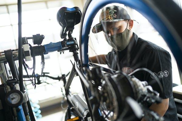 DJ Yann assembled a new electric bike for a customer at Erik's Bike Shop in Richfield, Minn., on Friday, March 26, 2021.    ] RENEE JONES SCHNEIDER