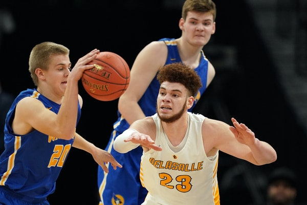 Forward Jamison Battle (23), playing for DeLaSalle against Waseca in the 2019 state tournament, committed to the Gophers through the transfer portal f