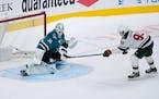 Sharks goaltender Martin Jones blocked a shot by Wild center Marcus Johansson during a shootout Monday night. San Jose won 4-3 in the eighth round of
