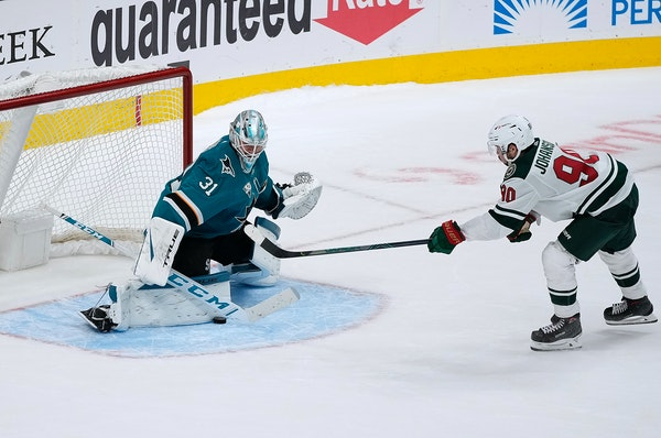 Sharks goaltender Martin Jones blocked a shot by Wild center Marcus Johansson during a shootout Monday night. San Jose won 4-3 in the eighth round of
