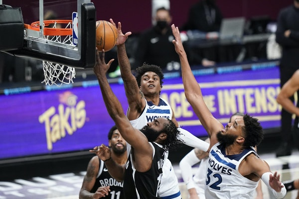 James Harden of the Nets evaded Timberwolves Karl-Anthony Towns (32) and Jaden McDaniels on Monday night.