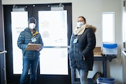 Andrea Crouse, left, and Miranda Pacheco at a recent COVID-19 vaccine clinic in Duluth's Central Hillside neighborhood.