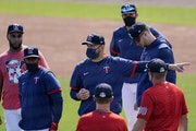 Twins manager Rocco Baldelli talks to players before a spring training game against the Braves on March 22 in Fort Myers