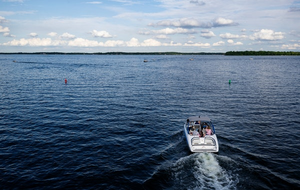 Boaters passed the Arcola Bridge on Lake Minnetonka. The coast is clear for boats to navigate Lake Minnetonka after an earlier than usual ice-out was