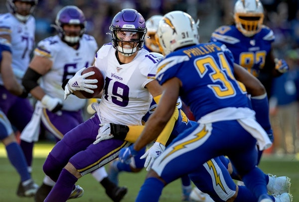Adam Thielen worked for extra yardage vs. the Chargers in 2019.