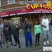 In an image taken from video, bystanders gathered near Cup Foods watching as police were restraining George Floyd.