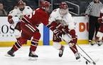 Matt Boldy (12) is leaving Boston College for the Wild.