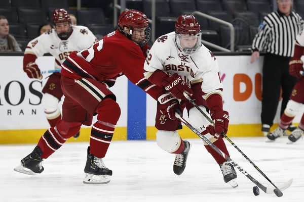Matt Boldy (12) is leaving Boston College for the Wild.