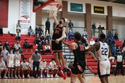Minnehaha Academy's Chet Holmgren (34) goes up for a first half dunk against Totino-Grace Friday night. Holmgren had 11 points in the first half as