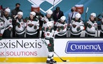 Minnesota Wild center Marcus Johansson (90) is congratulated by teammates after scoring a goal against the San Jose Sharks during the first period of