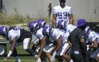 Injured Danielle Hunter (99) watched a practice during training camp in August.