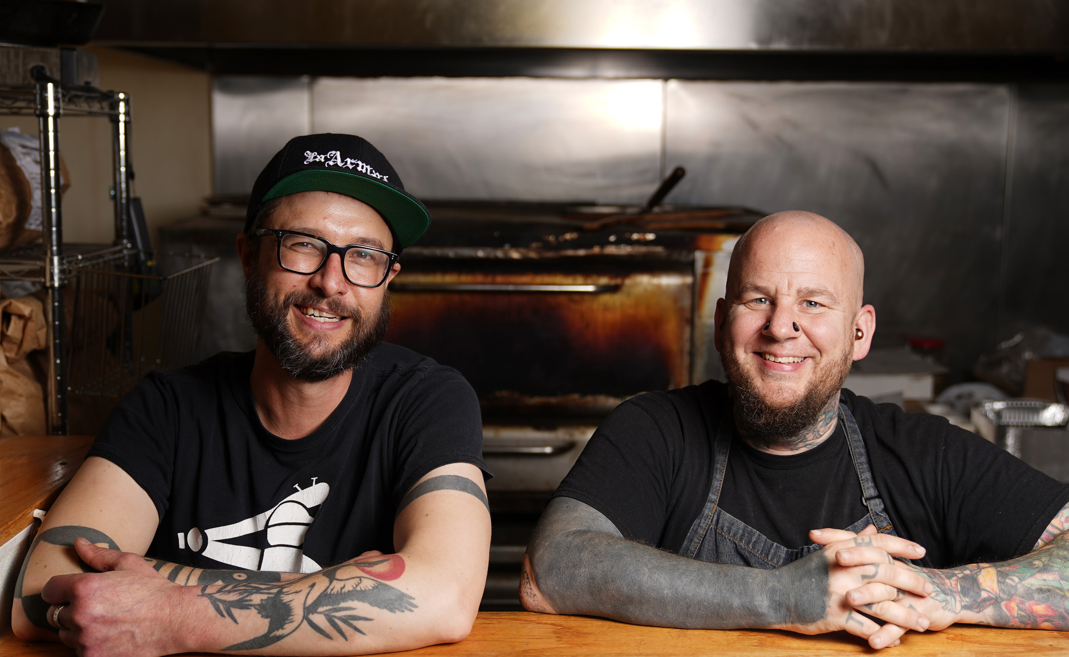 Eureka Compass Vegan Food founder Colin Anderson, left, along with chef John Stockman stood for a portrait as they took a break from dishing up orders.