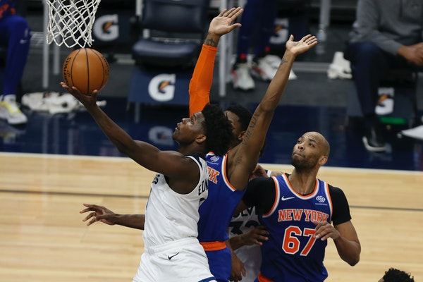 The Timberwolves' Anthony Edwards goes up to the basket past New York Knicks' RJ Barrett during the second half