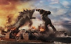 "Godzilla battles Kong in Warner Bros. Pictures' and Legendary Pictures' action adventure ""Godzilla vs. Kong."" (Courtesy of Warner Bros. Pictur"