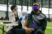 Former Minnesota Vikings linebacker  E.J. Henderson received the single-shot Johnson & Johnson vaccine Tuesday, at the Vikings practice facility in Ea