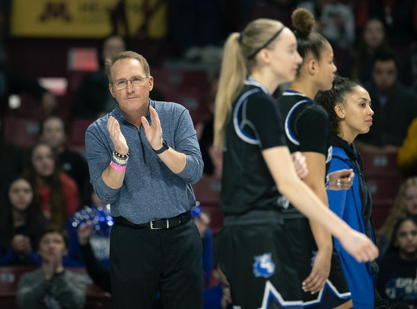 Hopkins' Head Coach Brian Cosgriff on the court as the team took on Cambridge-Isanti in the Class 4A girls' basketball quarterfinals at Williams Are