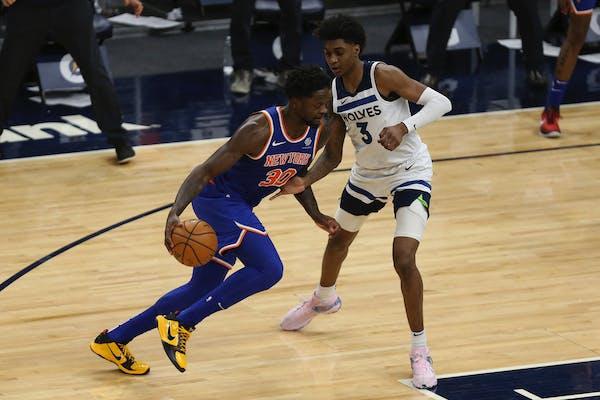 New York Knicks' Julius Randle (30) drives the ball around Minnesota Timberwolves' Jaden McDaniels (3) on Wednesday.