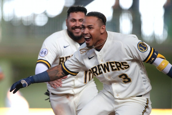 Milwaukee's Orlando Arcia celebrates with teammates after driving in the winning run during the 10th inning of the team's Opening Day game against
