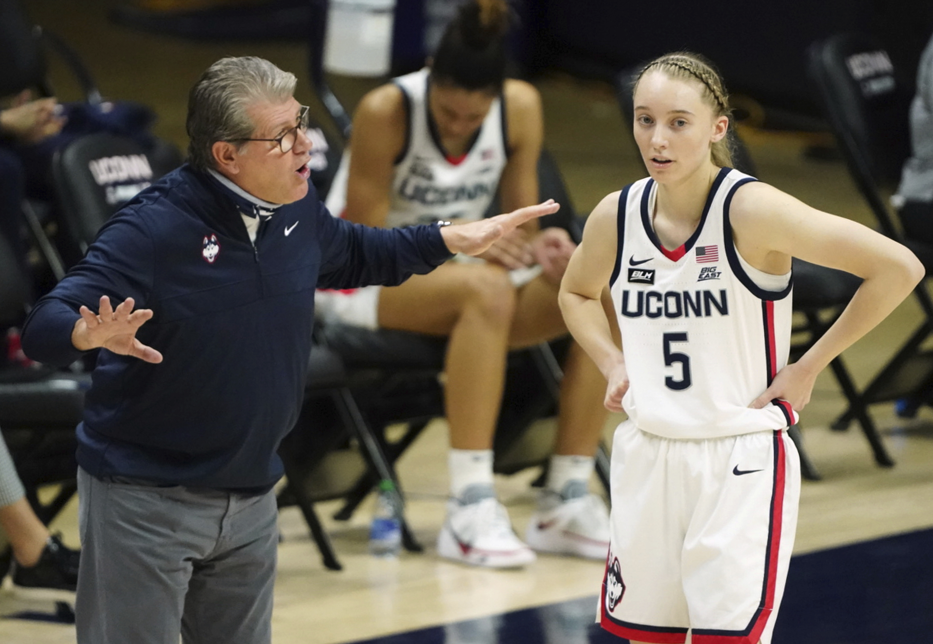 Connecticut head coach Geno Auriemma talks with Paige Bueckers during a game last month.